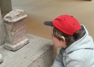 My son studying a Latin inscription in the Römisch-Germanisches Museum (Cologne)