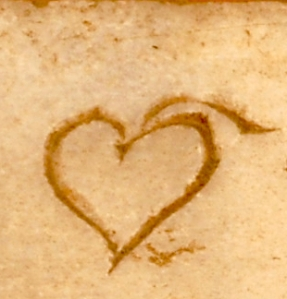 The love heart's precursor: hedera-shaped word division. – Detail from http://nvb.aarome.org/privato/articoli/1059_2.JPG.