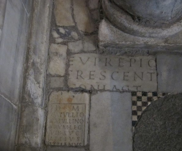 Inscriptions in S. Maria in Cosmedin. – Image source (cropped): https://www.flickr.com/photos/nemoleon/5019519722/in/set-72157624897040231.