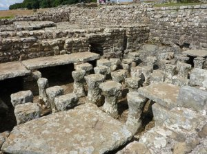 Roman heating arrangements at Housesteads Roman Fort. – Image source: http://media-cdn.tripadvisor.com/media/photo-s/04/63/70/eb/housesteads-fort-and.jpg.